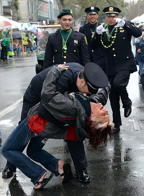 . Los Angeles Police Department\'s Jim Mcsorley dips Tina Shamlian in the middle of East Broad Street as he marches with fellow police officers during Savannah\'s 190-year-old St. Patrickís Day parade, Monday, March 17, 2014, in Savannah, Ga. (AP Photo/The Morning News, Richard Burkhart)