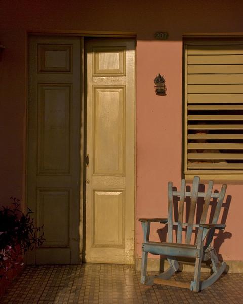 Cuba Cienfuegos chair on porch 8x10 6676.jpg