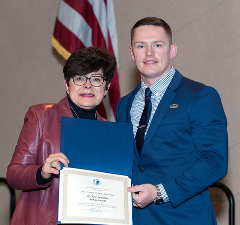 11/12/18 Wesley Bunnell | Staff CCSU held a Veterans Day Observance on Monday afternoon in Alumni Hall which featured honoring three local veterans. President Zulma Toro poses for a photo with U.S. Army Specialist Joshua Barnett.
