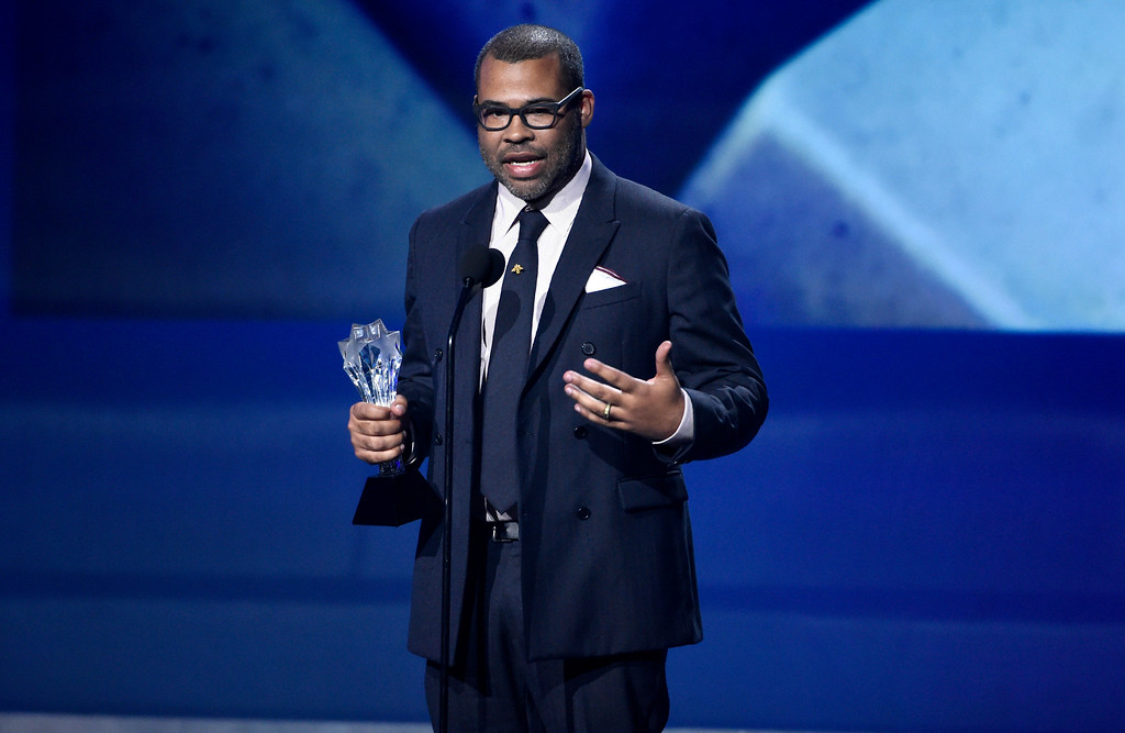 ". Jordan Peele accepts the award for best original screenplay for ""Get Out\"" at the 23rd annual Critics\' Choice Awards at the Barker Hangar on Thursday, Jan. 11, 2018, in Santa Monica, Calif. (Photo by Chris Pizzello/Invision/AP)"