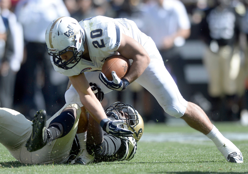 . University of Colorado\'s De\'Jon Wilson tackles Christian Reyes during a game against Charleston Southern on Saturday, Oct. 19, at Folsom Field in Boulder.  (Jeremy Papasso/Boulder Daily Camera)