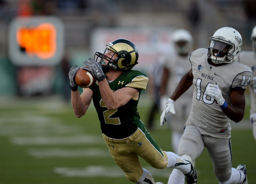 . Fort Collins, CO. NOVEMBER 09 : Thomas Coffman of Colorado State University (2) complete the pass from Garrett Grayson (18) for 41 yards in the 4th quarter of the game against University of Nevada at Hughes Stadium. Fort Collins. Colorado. November 09, 2013. CSU won 38-17. (Photo by Hyoung Chang/The Denver Post)