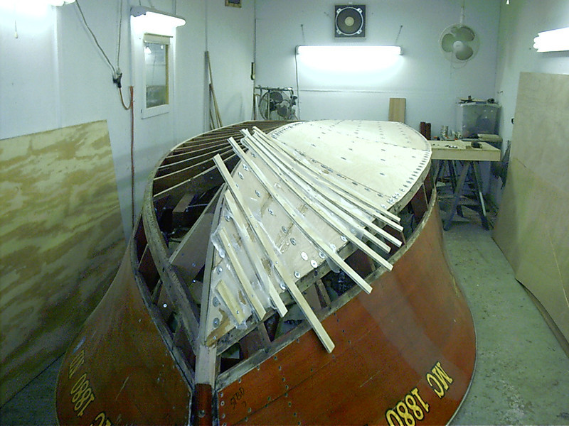 Starboard side glued down with West System epoxy and held in place with tempory fasteners.