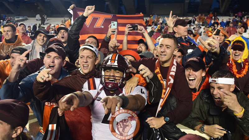 Virginia Tech quarterback Jerod Evans (4) celebrates with fans following the 34-3 victory. (Michael Shroyer/ TheKeyPlay.com)