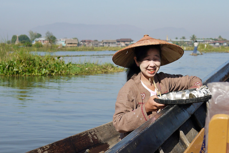 A vendor floats up to our boat to sell trinkets on Inle Lake, Burma (Myanmar).