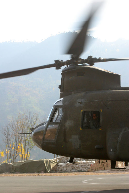 """A Chinook coming in to pick up more cargo.  The CH-47's flew in from Islamabad every morning and then ferried things from forward bases to the remote sites.  Some folks were calling the Chinook the """"National Bird of Pakistan""""!"""