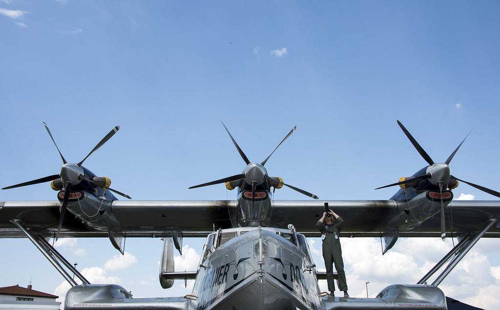 . A man takes a picture from the turboprop-powered amphibious aircraft Dornier Seastar during the International Air Show ILA in Schoenefeld near Berlin on May 20, 2014. According to the organizers, 1,203 exhibitors from 40 countries will attend the aerospace trade show running until May 25, 2014. AFP PHOTO / JOHANNES EISELEJOHANNES EISELE/AFP/Getty Images