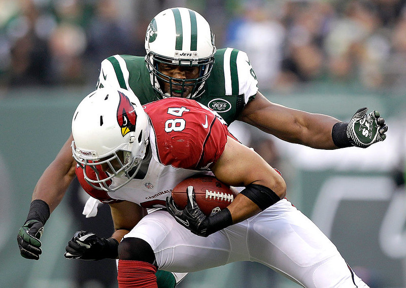 . Arizona Cardinals tight end Rob Housler (84) is tackled by New York Jets linebacker Calvin Pace during the second half of an NFL football game, Sunday, Dec. 2, 2012, in East Rutherford, N.J. (AP Photo/Kathy Willens)