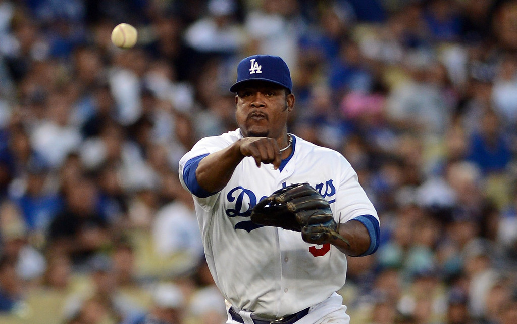 . The Dodgers\' Juan Uribe #5 throws to 1st base during their game against the Rockies at Dodgers Stadium Saturday, September 28, 2013. (Photo by Hans Gutknecht/Los Angeles Daily News)