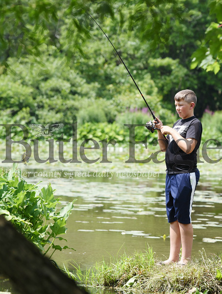 Harold Aughton/Butler Eagle: James Kinghorn, 12, of Mars reels in a sunfish at Preston Park Monday afternoon.