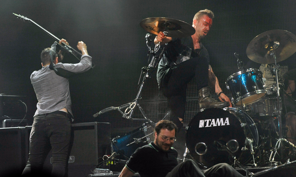 . Greg Puciato, right, and members of The Dillinger Escape Plan destroy their instruments at the close of their set at the 2013 Revolver Golden Gods Award Show at Club Nokia on Thursday, May 2, 2013 in Los Angeles. (Photo by Chris Pizzello/Invision/AP)