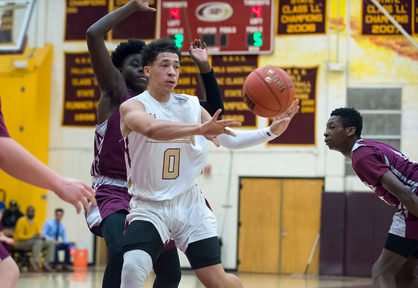 12/30/19 Wesley Bunnell | Staff New Britain boys basketball vs Naugatuck on Monday night at NBHS. Justice Carter (0) passes out to the wing.