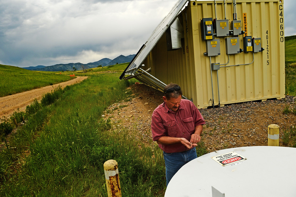 . Scott Surovchak, U.S. Department of Energy Site Manager for Rocky Flats, shows off the area were they test and treat water at the former site of the a nuclear weapons production facility, May 29, 2014. This June will be 25 years since the FBI raided Rocky Flats. (Photo by RJ Sangosti/The Denver Post)