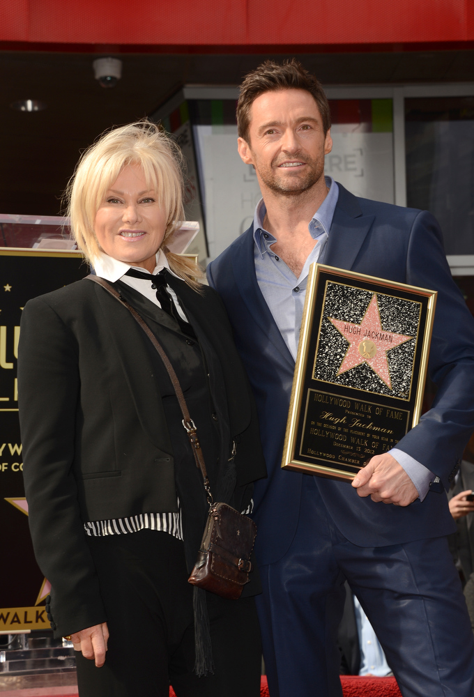 Description of . Actor Hugh Jackman and his wife Deborra-Lee Furness pose as Hugh Jackman is honored with a star on The Hollywood Walk Of Fame on December 13, 2012 in Hollywood, California.  (Photo by Jason Merritt/Getty Images)
