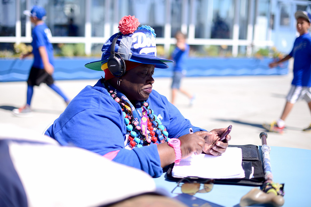 ". Jennifer Akinbayode, 52, of Pasadena\'s Jackie Robinson neighborhood hangs out at the gate of Dodger Stadium during their final game of the regular season Sunday, September 29, 2013. Akinbayode who calls herself the ""Black J Lo\"" has been coming to see the Dodgers for 39 years. (Photo by Sarah Reingewirtz/Pasadena Star-News)"
