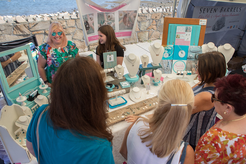 Swirls Jewelry owner Ellsa Sullivan has a big smile for the booth full of people browsing her products at the Plymouth Waterfront Festival on Saturday.  [Wicked Local Photo/Denise Maccaferri]