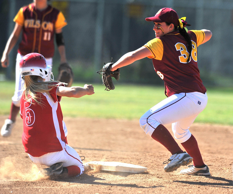 . LONG BEACH - 04/09/2013  (Photo: Scott Varley, Los Angeles Newspaper Group)  Lakewood vs Wilson girls softball at Joe Rodgers Field. Lakewood baserunner Lindsay Cerulle is forced out at 2B as Wilson\'s Zoe Stavrou tries to turn a double play with a late throw to 1B.