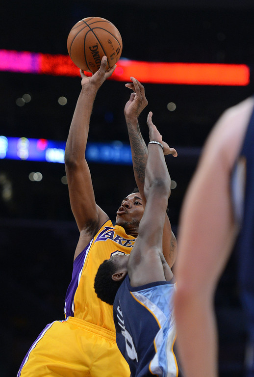 . The Lakers� Nick Young #0 shots during their game against the Grizzlies at the Staples Center in Los Angeles Friday, November 15, 2013. (Photo by Hans Gutknecht/Los Angeles Daily News)