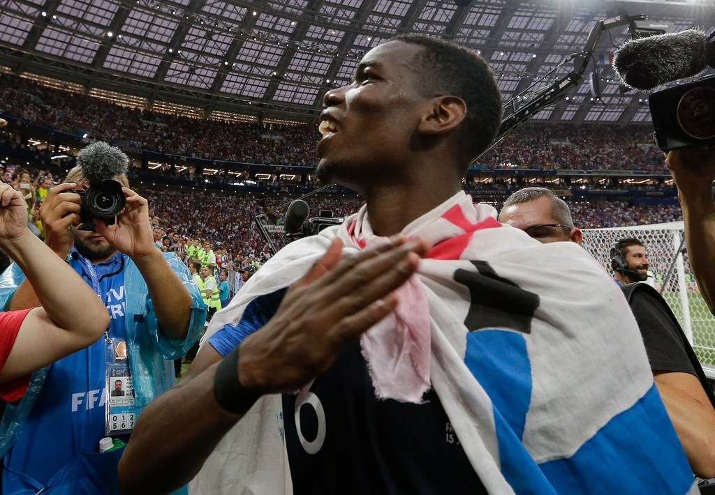 . France\'s Paul Pogba, right, celebrates at the end of the final match between France and Croatia at the 2018 soccer World Cup in the Luzhniki Stadium in Moscow, Russia, Sunday, July 15, 2018. France won 4-2. (AP Photo/Petr David Josek)