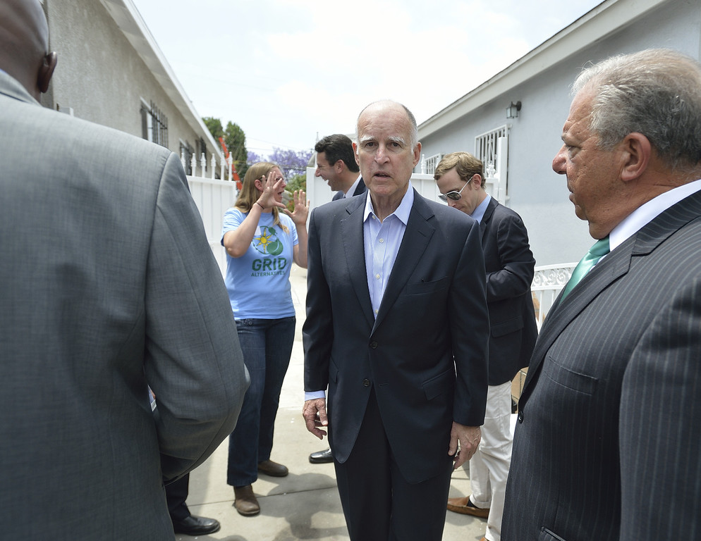 . LONG BEACH, CALIF. USA -- Gov. Jerry Brown after speaking at a north Long Beach (Calif.) home during a solar installation on Friday, May 17, 2013. This is the sixth family on this North Long Beach block to be assisted by the Single-family Affordable Solar Homes Program. This installation will allow the homeowners to save up to 90% on their electricity bills. Photo by Jeff Gritchen / Los Angeles Newspaper Group