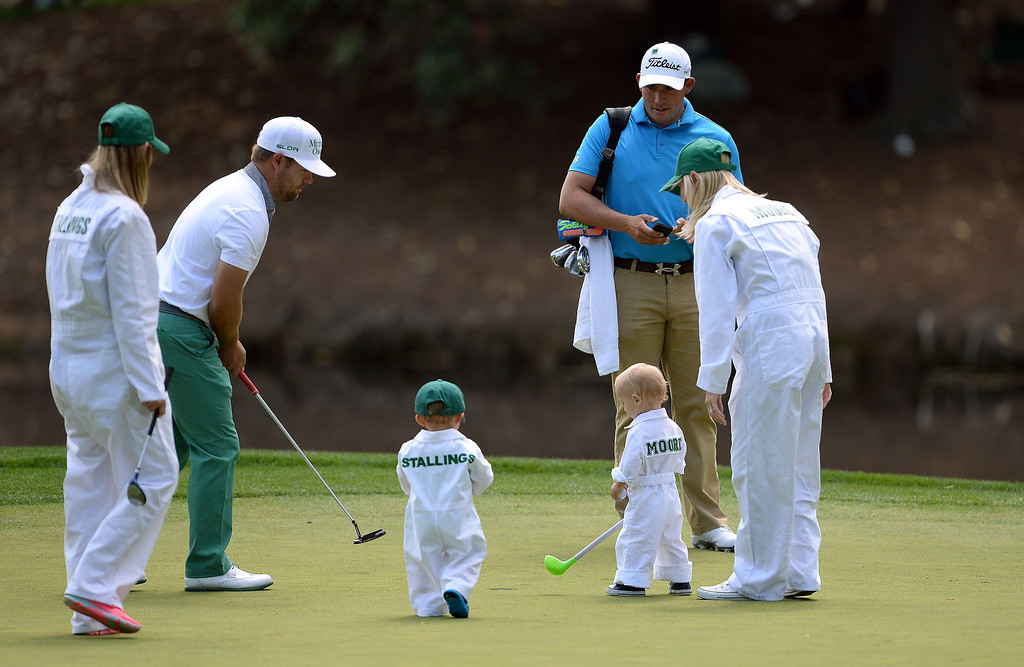 . Ryan Moore (R) and Scott Stalling of the US with their family play take part in the the Par 3 Contest prior the start of the 78th Masters Golf Tournament at Augusta National Golf Club on April 9, 2014 in Augusta, Georgia. Augusta National\'s trademark back-nine drama in the final round of the Masters could reach epic heights Sunday with a field that offers no clear favorite and several rising young stars. EMMANUEL DUNAND/AFP/Getty Images