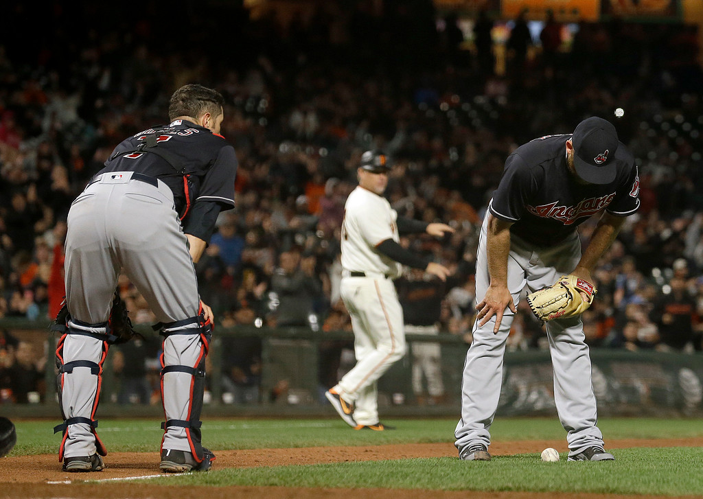 . Cleveland Indians pitcher Cody Allen, right, stands over the ball next to catcher Yan Gomes after San Francisco Giants\' Hunter Pence hit an infield single during the ninth inning of a baseball game in San Francisco, Tuesday, July 18, 2017. The Giants won 2-1 in ten innings. (AP Photo/Jeff Chiu)