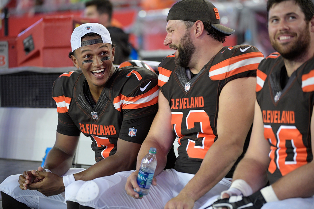 . Cleveland Browns quarterback DeShone Kizer (7), tackle Joe Thomas (73) and center Gabe Ikard (60) share a laugh during the second half of an NFL preseason football game against the Tampa Bay Buccaneers Saturday, Aug. 26, 2017, in Tampa, Fla. The Browns won 13-9. (AP Photo/Phelan M. Ebenhack)