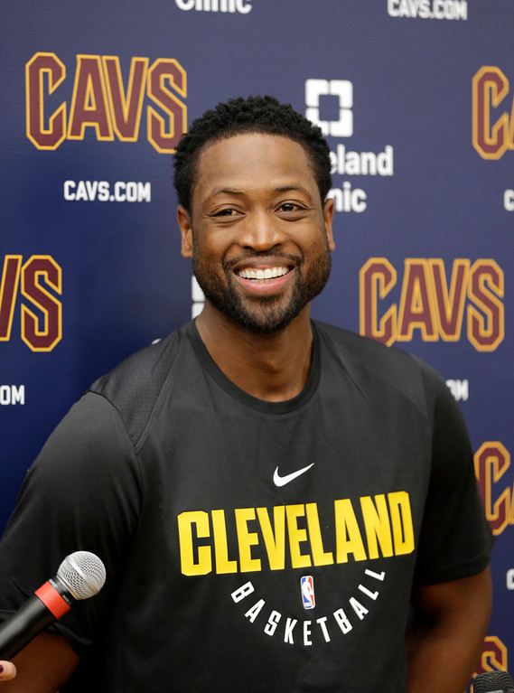 . Cleveland Cavaliers\' Dwyane Wade answers questions during a news conference at the team\'s training facility, Friday, Sept. 29, 2017, in Independence, Ohio. Wade once convinced LeBron James that Miami was the place to be. Seven years later, James lured Wade to Ohio for the chance to win another NBA title, together. (AP Photo/Tony Dejak)