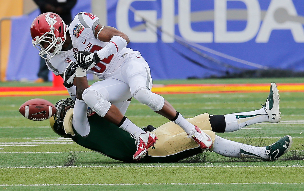 . Colorado State defensive back DeAndre Elliott, bottom, breaks up a pass intended for Washington State wide receiver Dom Williams during the first half of the NCAA New Mexico Bowl college football game on Saturday, Dec. 21, 2013, in Albuquerque, N.M. (AP Photo/Matt York)