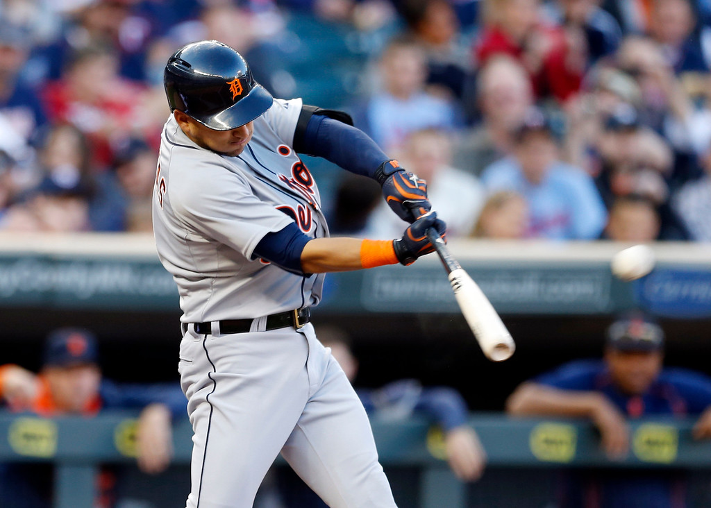 . Detroit Tigers� Jose Iglesias hits a solo home run off Minnesota Twins pitcher Tommy Milone in the first inning of a baseball game, Monday, April 27, 2015, in Minneapolis. (AP Photo/Jim Mone)
