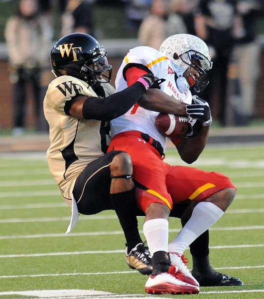 Kenny Okoro tackles MD receiver.jpg
