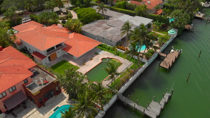 Aerial reveal waterfront mansions Miami Beach Indian Creek