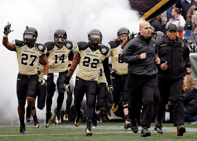 . Vanderbilt head coach James Franklin, second from right, leads his team onto the field for the Music City Bowl NCAA college football game against North Carolina State, Monday, Dec. 31, 2012, in Nashville, Tenn. (AP Photo/Mark Humphrey)
