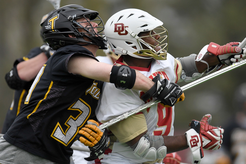 . DENVER, CO - MAY 15:  Pat Conroy (34) of the Towson gets physical with  Trevor Baptiste (9) of the Denver during the first half. University of Denver hosted Towson University in an NCAA tournament game on Sunday, May 15, 2016. (Photo by AAron Ontiveroz/The Denver Post)