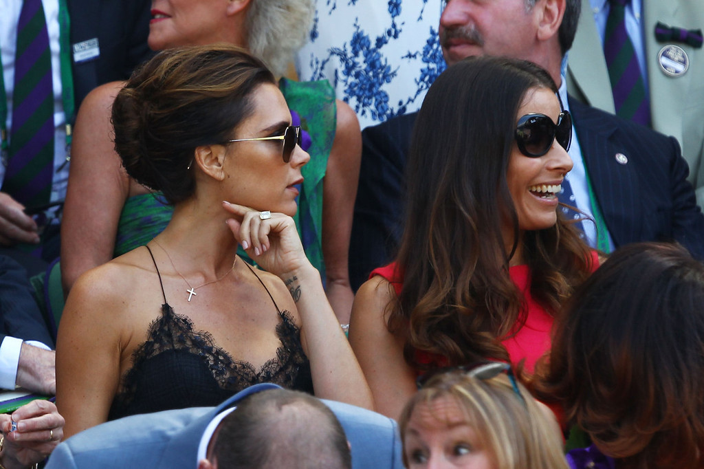 . Victoria Beckham and Tana Ramsey attend the Gentlemen\'s Singles Final match between Andy Murray of Great Britain and Novak Djokovic of Serbia on day thirteen of the Wimbledon Lawn Tennis Championships at the All England Lawn Tennis and Croquet Club on July 7, 2013 in London, England.  (Photo by Clive Brunskill/Getty Images)
