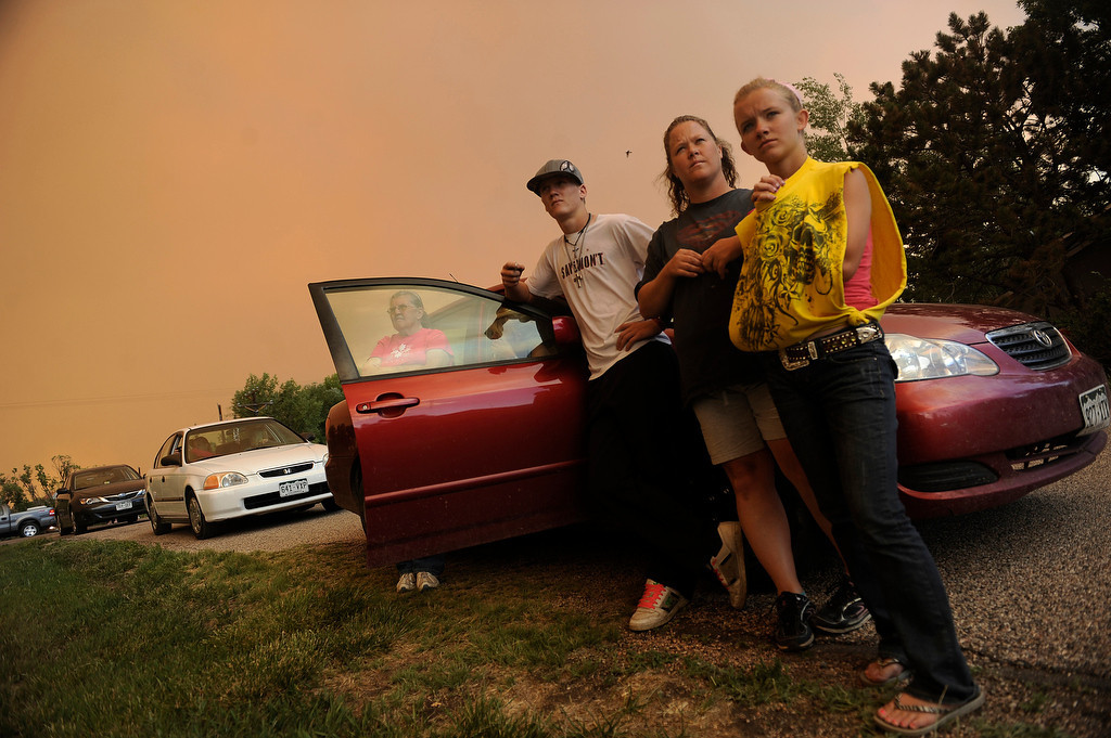 . Tinisha Brunmeier, 15, left, her mother Danielle Stuck, Tyler Cumegys and Carol Skogg, far right, watch as the High Park Fire continues to burn. The High Park fire northwest of Fort Collins continues to burn today June 10th, 2012.  The fire is now estimated at over 14,000 acres and still zero percent containment. Helen H. Richardson, The Denver Post