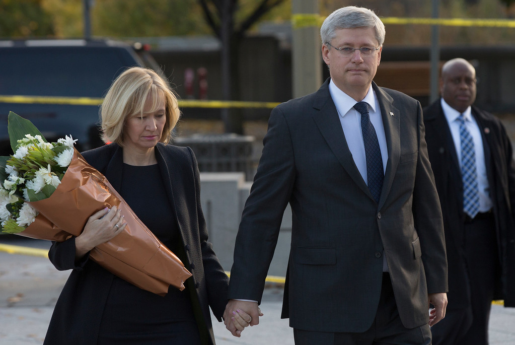 . In this handout photo provided by the PMO, Prime Minister Stephen Harper (R) and his wife Laureen Harper arrive at the National War Memorial to lay flowers in honour of Corporal Nathan Cirillo who was killed yesterday while standing guard at the memorial, on October 23, 2014 in Ottawa, Canada.   (Photo by Jason Ransom/PMO via Getty Images)