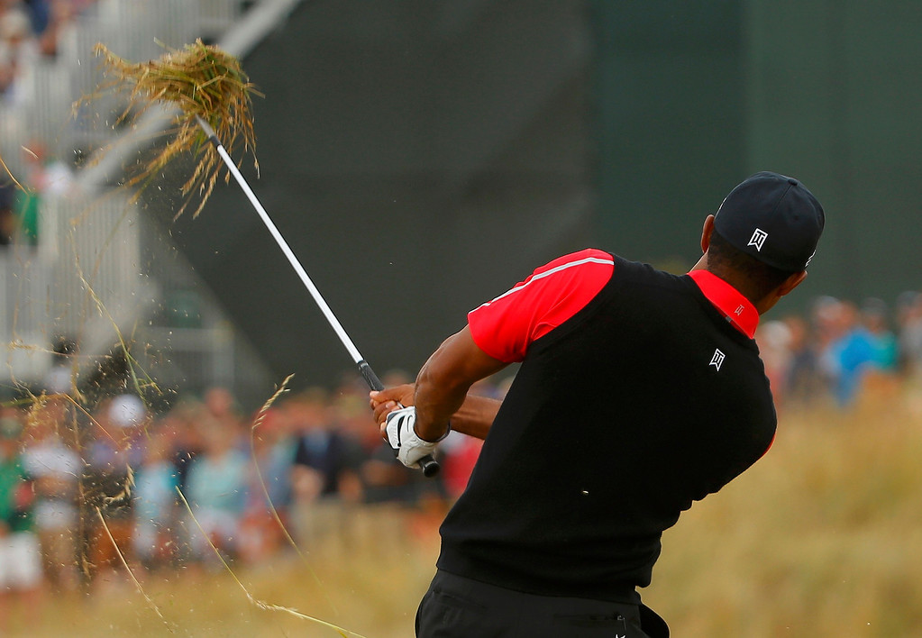 . Tiger Woods of the U.S. hits out of the rough on the tenth hole during the final round of the British Open golf championship at Muirfield in Scotland July 21, 2013.     REUTERS/Brian Snyder
