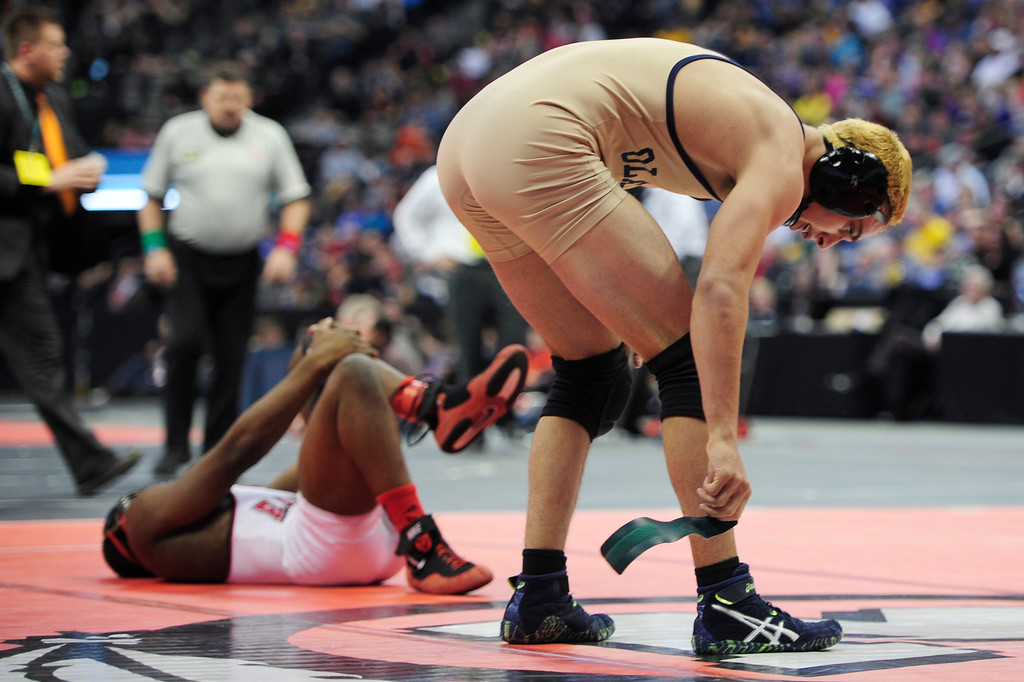 . Jacob Jimenez of Olathe takes off his band after defeating Rusty Lohr of Eaton in the championship match of Class 3A 152 pounds division during the finals of the 2016 Colorado Wrestling State Championships at the Pepsi Center on February 20, 2016 in Denver, Colorado. (Photo by Brent Lewis/The Denver Post)