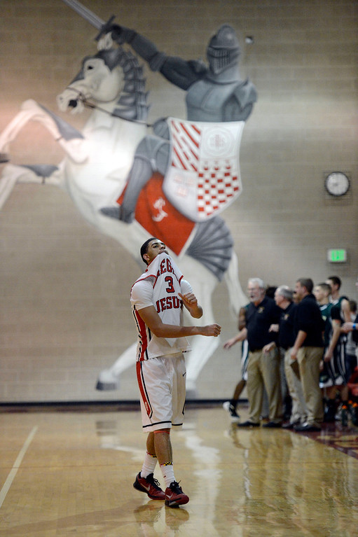 . LITTLETON, CO. - JANUARY 29: Regis Josh Perkins (3) walks off the court dejected after fouling out with second in the game against Mountain Vista  January 29, 2013 at Regis.  (Photo By John Leyba / The Denver Post)