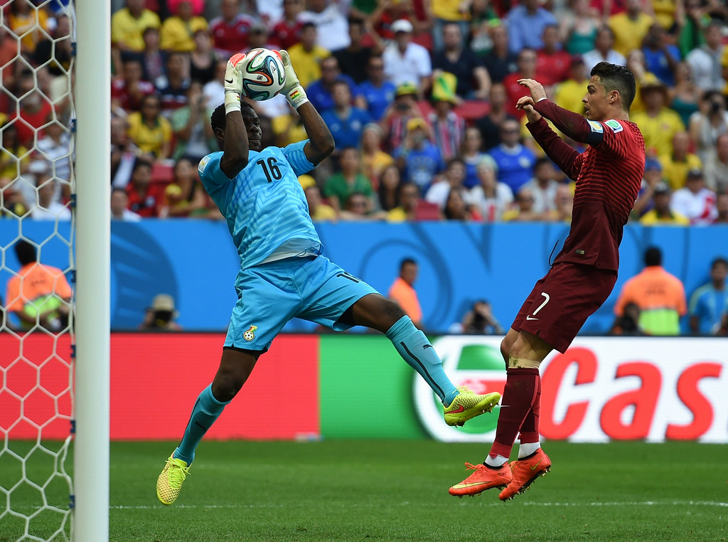 . Ghana\'s goalkeeper Fatau Dauda (L) and Portugal\'s forward and captain Cristiano Ronaldo vie for the ball during the Group G football match between Portugal and Ghana at the Mane Garrincha National Stadium in Brasilia during the 2014 FIFA World Cup on June 26, 2014. CARL DE SOUZA/AFP/Getty Images