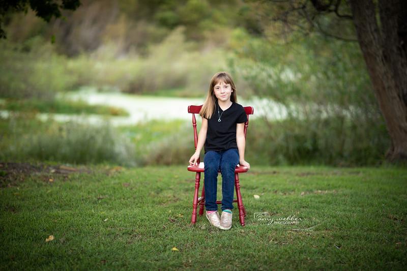 sarah sitting red chair.jpg