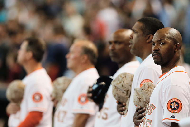 . Houston Astros manager Bo Porter #16 (R) waits with his team before the start of the game against the Colorado Rockies at Minute Maid Park on May 27, 2013 in Houston, Texas. (Photo by Scott Halleran/Getty Images)
