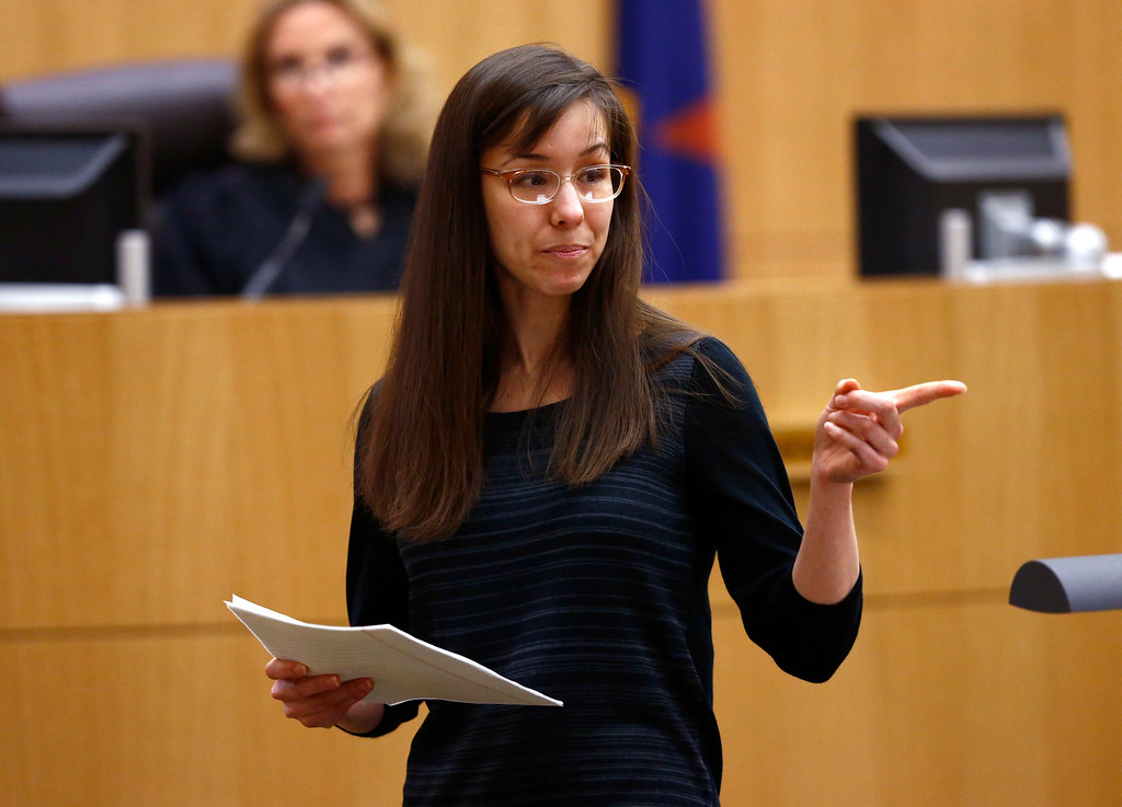 . Jodi Arias points to her family as a reason for the jury to give her a life in prison sentence instead of the death penalty on Tuesday, May 21, 2013, during the penalty phase of her murder trial at Maricopa County Superior Court in Phoenix.  Arias was convicted of first-degree murder in the stabbing and shooting to death of Travis Alexander, 30, in his suburban Phoenix. (AP Photo/The Arizona Republic, Rob Schumacher, Pool)