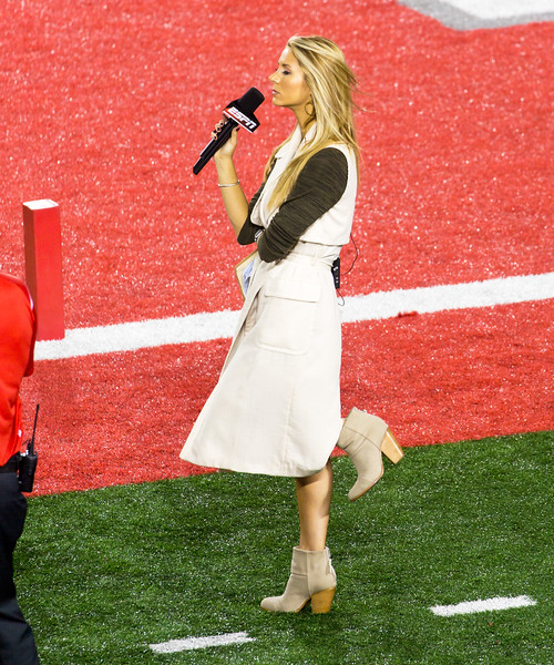 ESPN's Laura Rutledge (former Miss Florida) hangs around the Louisville side of the field.  (After all, they were going to blow UH out.)