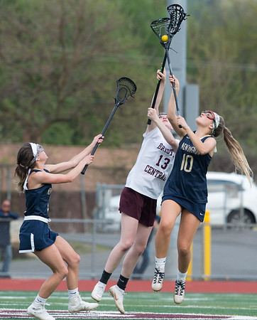 05/10/19 Wesley Bunnell | Staff Newington girls lacrosse defeated Bristol Central in an away game at Bristol Central High School on Friday afternoon. Newington's Morgan Hellman (1) BC's Jade Longo (13) and Hannah Drew (10).