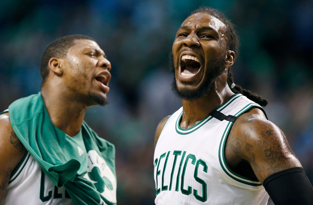 . Boston Celtics\' Jae Crowder celebrates beside teammate Marcus Smart after hitting a three-pointer during the third quarter of a second-round NBA playoff series basketball game against the Washington Wizards, Sunday, April, 30, 2017, in Boston. The Celtics won 123-111. (AP Photo/Michael Dwyer)