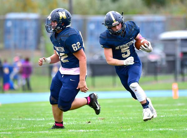 10/12/2019 Mike Orazzi | StaffrNewington High School's Gunnar Johnson (5) follows blocker Tymothy Sullivan into the end zone for a TD during Saturday's football game with Platt in Newington.