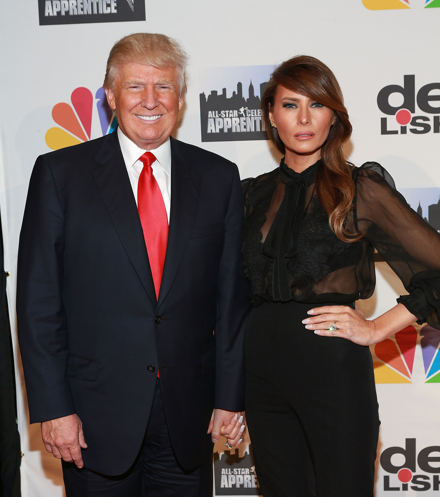 "Description of . Donald Trump (L) and Melania Trump attend ""All Star Celebrity Apprentice\"" Finale at Cipriani 42nd Street on May 19, 2013 in New York City.  (Photo by Robin Marchant/Getty Images)"