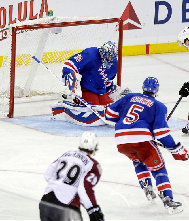 . Colorado Avalanche\'s Nathan MacKinnon (29) watches a puck he shot past New York Rangers goalie Henrik Lundqvist (30), of Sweden, for a goal during the third period of an NHL hockey game Thursday, Nov. 13, 2014. The Colorado Avalanche won 4-3 in a shootout. (AP Photo/Frank Franklin II)